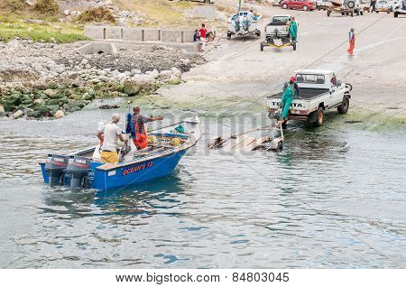 Crayfish Boat Being Pulled Onto Trailer At Kleinmond Harbor