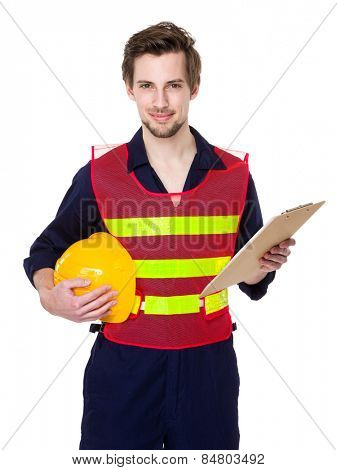 Construction worker hold with clipboard and hardhat