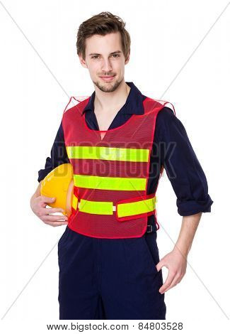 Builder with waistcoat and hold a helmet