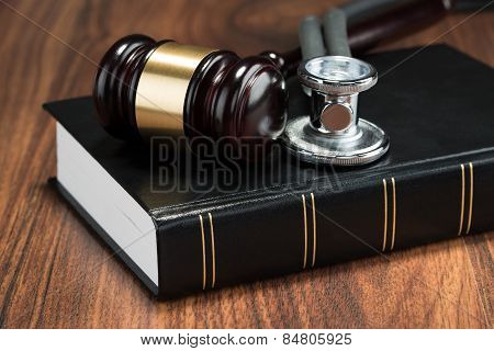 Gavel And Stethoscope On Book