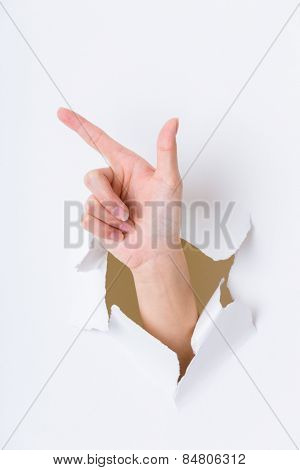Tick gesture breaking through the paper wall
