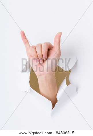 Six finger breaking through paper wall