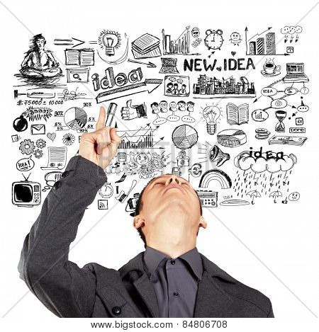 Idea concept with businessman looking upwards and showing something with finger on sketch background