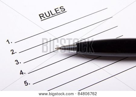 Close Up Of Sheet Of Paper With Rules Blank And Pen