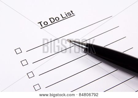 Close Up Of Blank To Do List And Pen