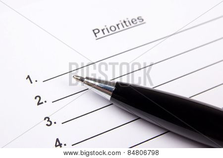 Close Up Of Blank List Of Priorities And Pen