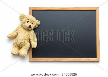 blank chalkboard and teddy bear on white background