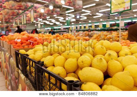 Crates with citrus fruits in a food store