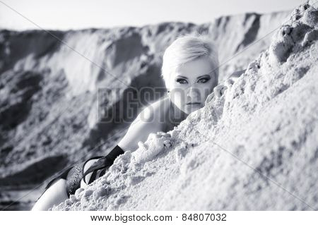 summer portrait of attractive woman in sand