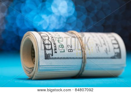Us Dollars Rolled Up And Tightened With Band