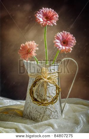 Jug vase filled with pink Gerbera flowers