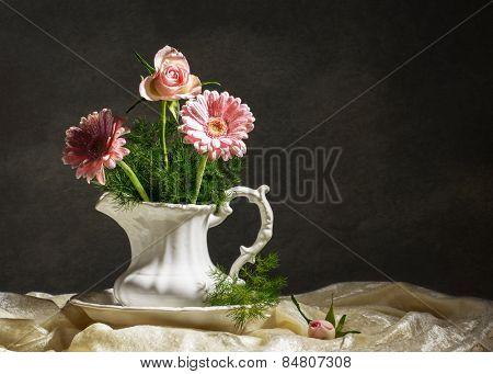Flower arrangement in jug with artistic lighting
