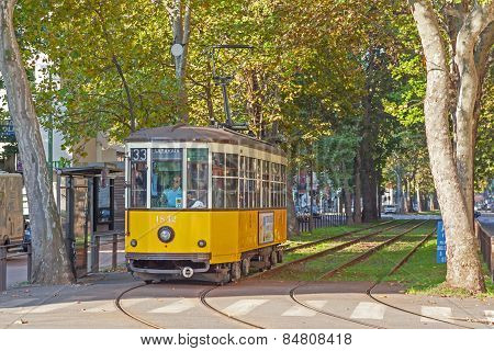 Old Yellow Tram On The Street Of Milan