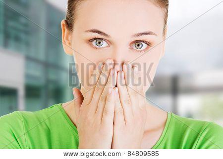 Beautiful young caucasian woman shocked
