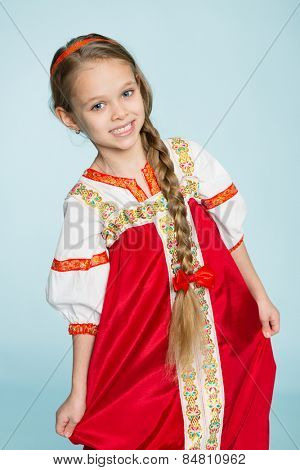 Girl in traditional Russian folk costume. Girl seven years.