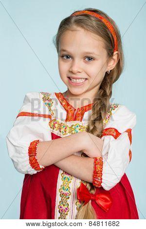 Little girl in traditional Russian folk costume. Girl seven years.