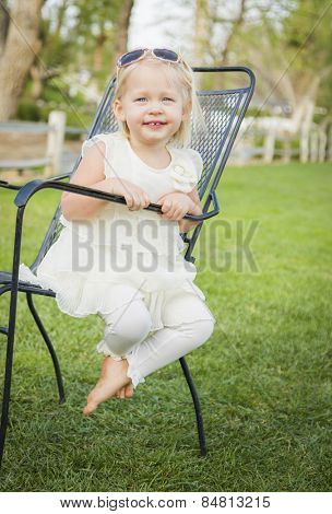 Cute Playful Baby Girl Portrait Outside at the Park.
