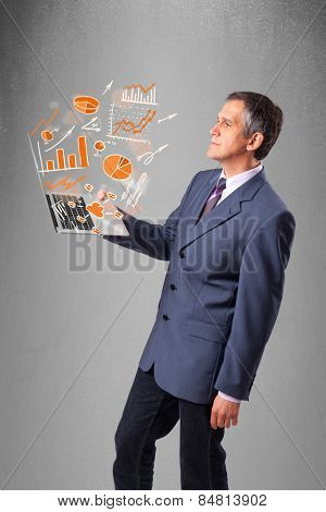 Businessman in suit holding notebook with graphs and statistics