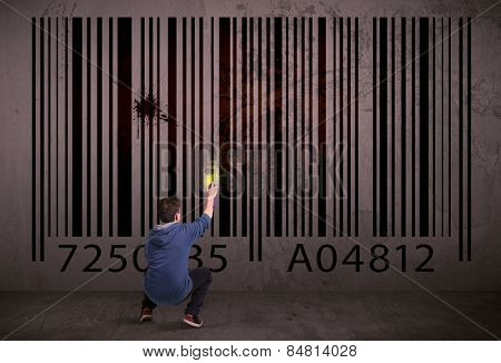Young urban painter drawing a barcode on the wall