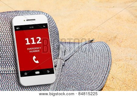 Mobile Phone With Emergency Number 112 On The Beach