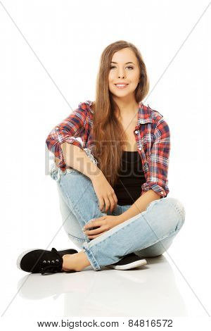 Happy smiling woman sitting cross-legged