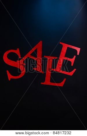 Sale on colorful dark background