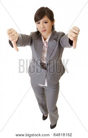 Angry business lady give you a thumb down gesture on white background.