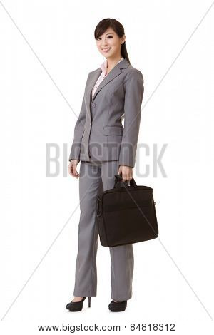Asian business woman standing and holding briefcase, full length portrait isolated on white background.