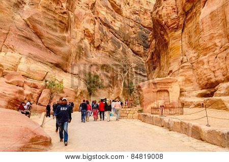 Tourists Go Through The Gorge In Petra, Jordan