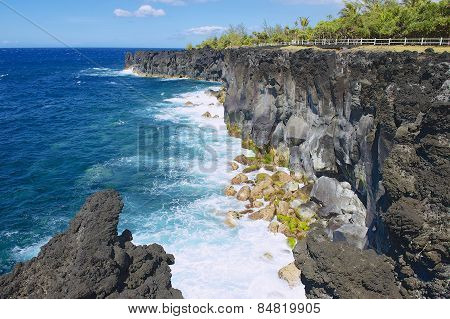 Black volcanic lava sea coast at Reunion island, France.
