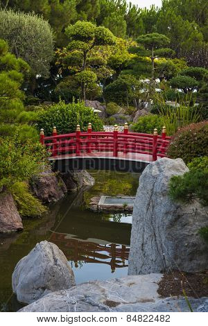 MONTE CARLO, MONACO - OCTOBER 3, 2014: View of Japanese garden with red bridge in Monte Carlo, Monaco