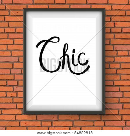Chic Text in a White Frame Hanging on Brick Wall