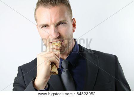 businessman eating a pancake