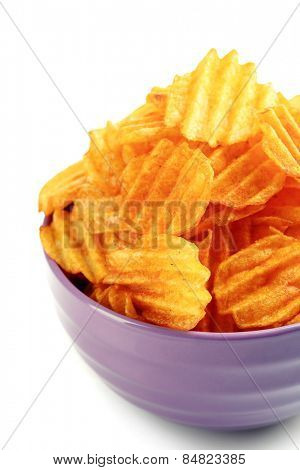 Delicious potato chips in bowl isolated on white