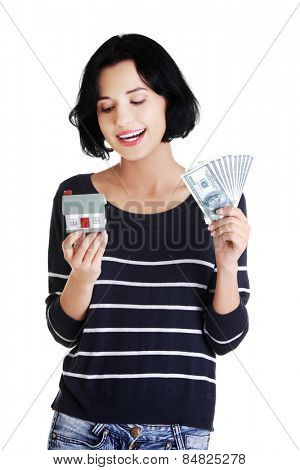 Young smiling woman holding dollars