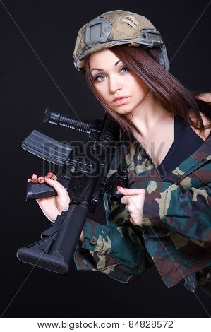 Woman In The Military Uniform With An Assault Rifle On The Shoulder