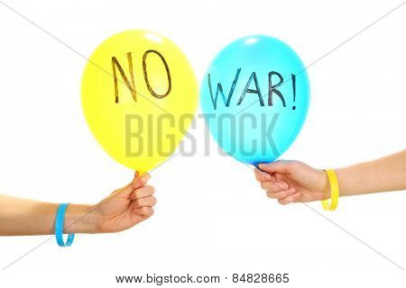 Hands holding blue and yellow balloons - no war concept