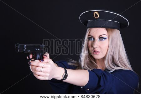 Woman In A Navy Uniform With A Gun