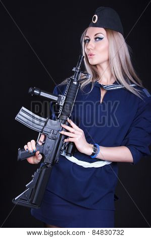 Woman In A Navy Uniform With An Assault Rifle