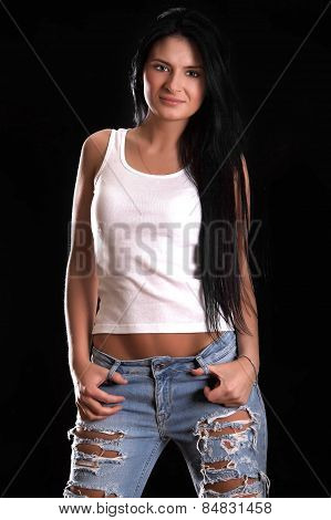 Portrait Of A Happy Young Woman In A Ragged Jeans And White Sleeveless Shirt