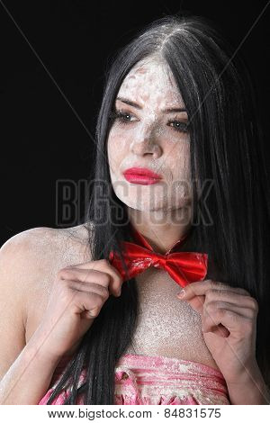 Portrait Of A Woman In A Red Bow-tie Covered By White Powder