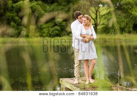 romantic young couple standing by the river