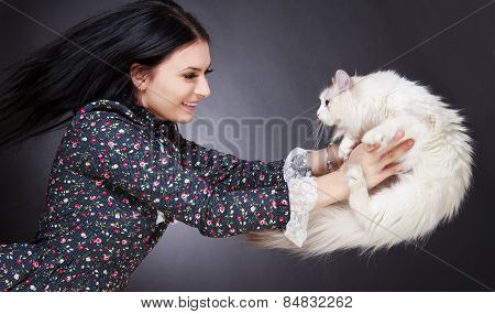 Young Attractive Woman Playing With A Cat