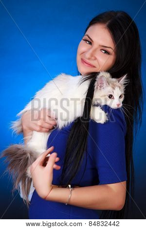 Young Attractive Woman In A Blue Evening Dress With A White Cat
