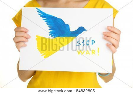 Woman holding paper dove with painted Ukraine flag, isolated on white