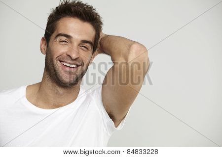 Mid adult man in t-shirt laughing