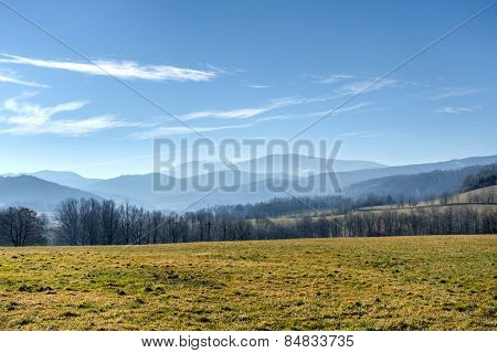 Spring Countryside With Meadow, Trees And Mountains