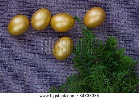 Golden eggs and fern leaves