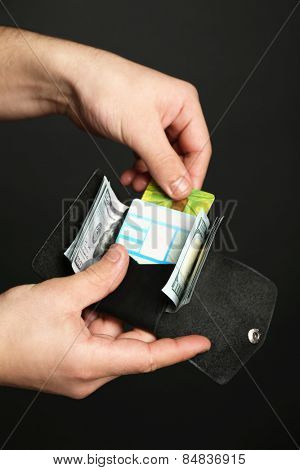 Man holding hand made leather wallet with money