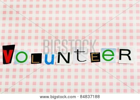 Inscription volunteer on colorful background